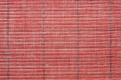 Texture of a red straw mat Royalty Free Stock Images