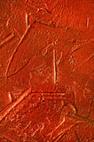 Texture of the red stucco wall with dabs Stock Images