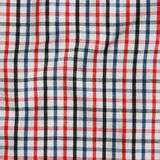 Texture of a red and white checkered picnic blanke Stock Image