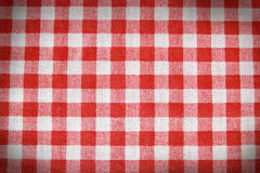 Texture of a red and white checkered picnic blanket. Royalty Free Stock Photos