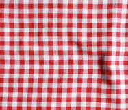 Texture of a red and white checkered picnic blanket. Red linen tablecloth. Texture of a red and white checkered picnic blanket Stock Photos