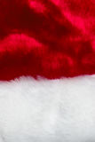 The texture of red and white fur hat of Santa Claus. Christmas design Royalty Free Stock Photography