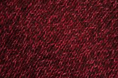 Texture of red woven wool knitted sweater. Fabric background Royalty Free Stock Photography