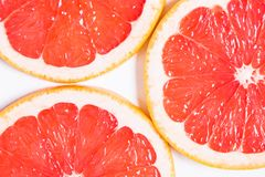 Texture of a ripe grapefruit slice, closeup.  royalty free stock photography