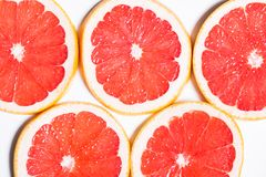 Texture of a ripe grapefruit slice, closeup.  royalty free stock photos
