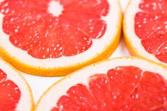 Texture of a ripe grapefruit slice, closeup.  Royalty Free Stock Image