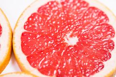 Texture of a ripe grapefruit slice, closeup.  Stock Images