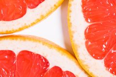 Texture of a ripe grapefruit slice, closeup.  Stock Photography