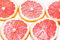 Texture of a ripe grapefruit slice, closeup.  Royalty Free Stock Photo