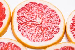 Texture of a ripe grapefruit slice, closeup.  Royalty Free Stock Photos