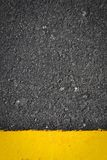 Texture on road and yellow line. Background Royalty Free Stock Images