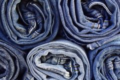 Texture of rolled jeans close-up stock photography