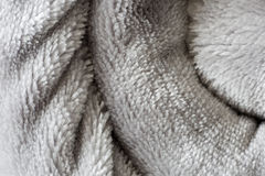 Texture of a rolled up blanket. Stock Photos