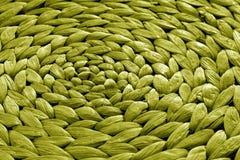 Texture ronde de tapis de paille dans la couleur jaune Photo libre de droits