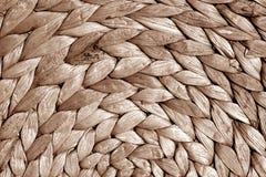 Texture ronde de tapis de paille dans le ton brun Photographie stock
