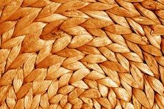 Texture ronde de tapis de paille dans le ton orange Photo libre de droits