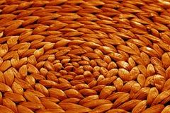 Texture ronde de tapis de paille dans le ton orange Image libre de droits