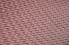 The texture of the roof of painted metal. Close-up detailed view of roof covering for pitched roof. High quality roofin. G stock photo