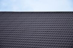 The texture of the roof of painted metal. Close-up detailed view of roof covering for pitched roof. High quality roofin. G royalty free stock image