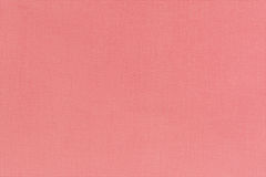 Texture of the rose color linen fabric. Close-up view for the ba Stock Photos