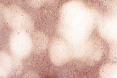 Texture rose de ciment avec le fond de bokeh de lumière de biscuit Photographie stock libre de droits
