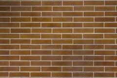 Texture rougeâtre de briques de mur urbain photo stock
