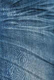 Texture: rough and bleached blue jeans Stock Image