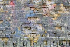 The texture of the rough old brick wall. Painted with paint of different colors Royalty Free Stock Photography