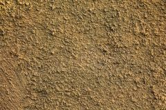The texture of a rough plastered brown wall of some old house.  royalty free stock photos