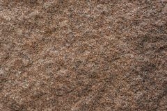 The texture of rough surface of red granite Close-up. The texture of rough surface of red granite Royalty Free Stock Image