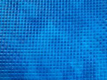 Texture rubber non-slip blue mat with a pattern of square small tiles. The background stock photography
