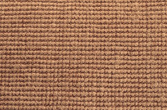 Texture of rug. Texture material rug brown background mat pattern Royalty Free Stock Photos