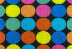 Texture of the rug with colored circles. Background for design and decoration.  stock photography