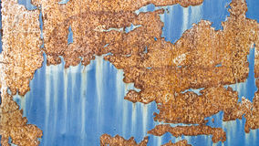 Texture of rust pattern on blue metal background.  Stock Photos