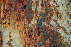 Texture of rusty iron, cracked paint on an old metallic surface, sheet of rusty metal with cracked and flaky paint,  corrosion, de. Cay metal background, decay Royalty Free Stock Photo