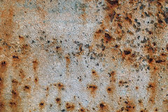 Texture of rusty iron, cracked paint on an old metallic surface, sheet of rusty metal with cracked and flaky paint,  corrosion, de. Texture of rusty iron Stock Image