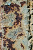 Texture of rusty iron, cracked paint on an old metallic surface, sheet of rusty metal with cracked and flaky paint,  corrosion, de. Cay metal background, decay Royalty Free Stock Photography