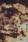 Texture of rusty iron, cracked paint on an old metallic surface, sheet of rusty metal with cracked and flaky paint,  corrosion, de. Cay metal background, decay Stock Image