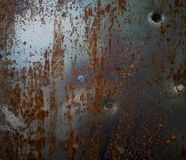Texture of rusty metal with bullet holes.  royalty free stock images