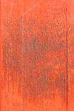 Texture of rusty metal painted in red paint. Texture of rusty worn metal under red paint Royalty Free Stock Image