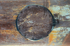 Texture, rusty metal, pipe with a closed hatch Royalty Free Stock Image