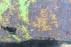 Texture rusty metal wall with peeling paint. Abstract. Stock Images