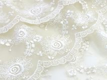 Texture sack sacking fabric and white lace background. Beautiful texture sack sacking fabric and white lace background royalty free stock photo