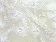 Texture sack sacking fabric and white lace background. Beautiful texture sack sacking fabric and white lace background royalty free stock image