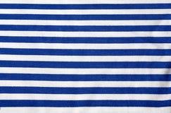 Texture sailor. Striped cloth. Horizontall blue stripes. Clothing sailor. Background. Texture stock photography