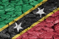 Texture of Saint Kitts flag. Texture of Saint Kitts Flag on a decorative tree bark Royalty Free Stock Photography