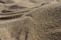Texture of sand. A closeup view of grains of sand and its textures Stock Photography