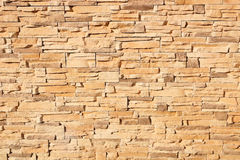 Texture of a sand-colored brick wall. Sand-colored brick wall in a sunny day Stock Images