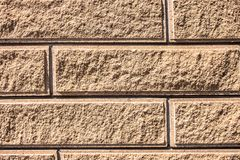 Texture of sand-colored bricks background close up royalty free stock images
