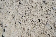 Texture sand. Texture of grey sand with stone Royalty Free Stock Images